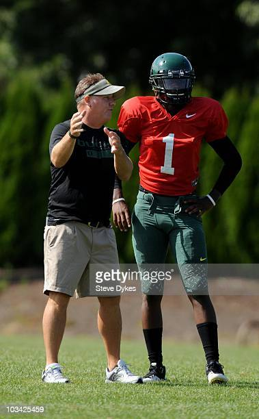 Head coach Chip Kelly gives some pointer to Quarterback Darron Thomas of the Oregon Ducks during practice on August 17, 2010 in Eugene, Oregon.