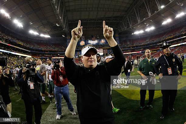 Head coach Chip Kelly of the Oregon Ducks celebrates their 35 to 17 win over the Kansas State Wildcats in the Tostitos Fiesta Bowl at University of...