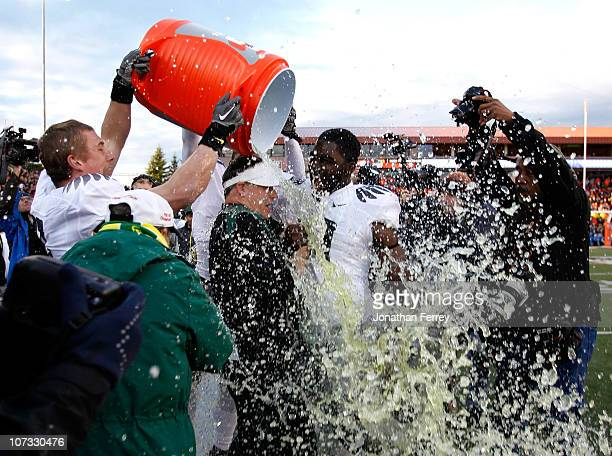 Head Coach Chip Kelly of the Oregon Ducks laughs with Drew Davis after having Gatorade dumped on him after the 3720 victory over the Oregon State...
