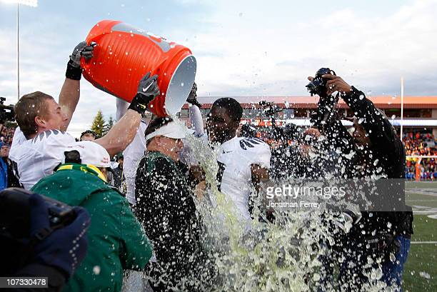 Head Coach Chip Kelly of the Oregon Ducks laughs with Drew Davis after having Gatorade dumped on him after the 37-20 victory over the Oregon State...
