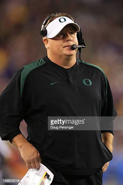 Head coach Chip Kelly of the Oregon Ducks looks on in the third quarter of the Tostitos Fiesta Bowl against the Kansas State Wildcats at University...