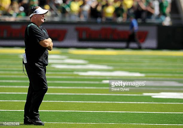 Head coach Chip Kelly of the Oregon Ducks looks out at the action on the field in the second quarter of the game against the New Mexico Lobos at...