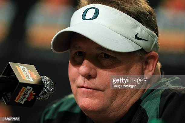 Head coach Chip Kelly of the Oregon Ducks participates in a post-game press conference after they defeated the Kansas State Wildcats 35 to 17 in the...