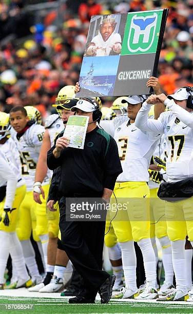 Head coach Chip Kelly # of the Oregon Ducks signals in a play from the sidelines in the third quarter of the game against the Oregon State Beavers on...