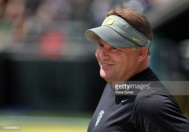 Head coach Chip Kelly of the Oregon Ducks smiles as he looks on from the sidelines during the third quarter of the Oregon Spring Game game at Autzen...
