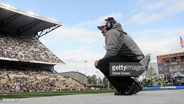 Head coach Chip Kelly of the Oregon Ducks squats along the sidelines in the fourth quarter of the game against the Washington Huskies at Husky...