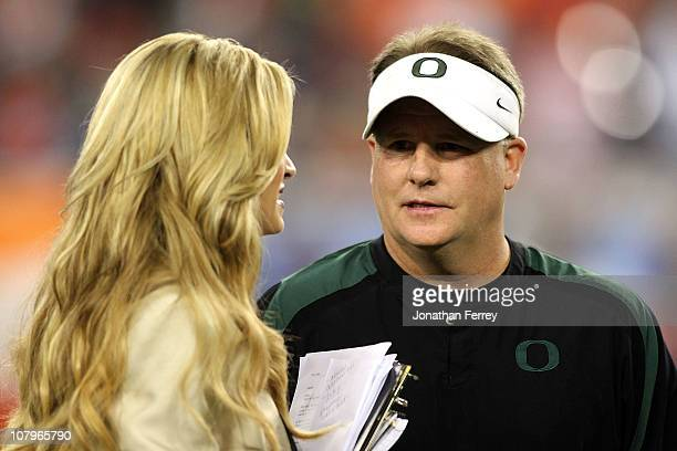 Head coach Chip Kelly of the Oregon Ducks talks with ESPN sideline reporter Erin Andrews before the Tostitos BCS National Championship Game between...