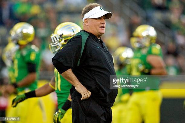Head coach Chip Kelly of the Oregon Ducks watches warm-ups before the game against the Arkansas State Red Wolves on September 1, 2012 at Autzen...
