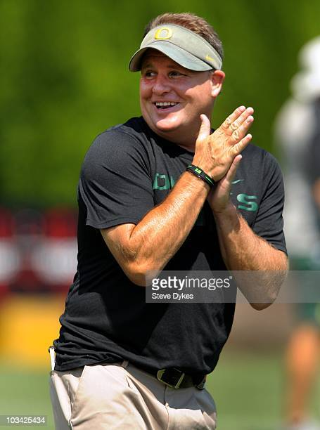 Head coach Chip Kelly of the Oregon shares a laugh during the Ducks practice on August 17, 2010 in Eugene, Oregon.