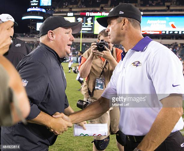 Head coach Chip Kelly of the Philadelphia Eagles shakes hands with John Harbaugh of the Baltimore Ravens after the game on August 22 2015 at Lincoln...
