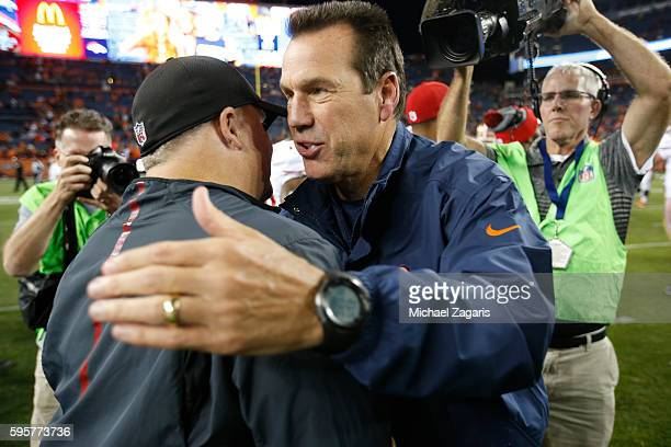 Head Coach Chip Kelly of the San Francisco 49ers and Head Coach Gary Kubiak during the game against the Denver Broncos at Sports Authority Field on...