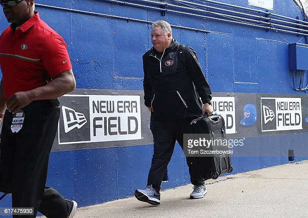 Head coach Chip Kelly of the San Francisco 49ers arrives at the stadium before the start of NFL game action against the Buffalo Bills at New Era...