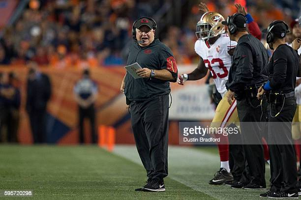 Head coach Chip Kelly of the San Francisco 49ers coaches from the sideline during a preseason NFL game against the Denver Broncos at Sports Authority...