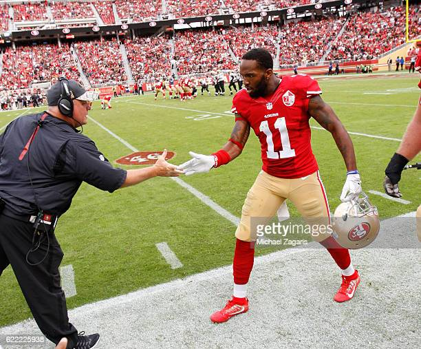 Head Coach Chip Kelly of the San Francisco 49ers congratulates Quinton Patton on the sideline during the game against the New Orleans Saints at Levi...