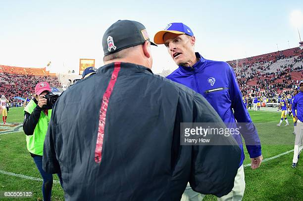 Head coach Chip Kelly of the San Francisco 49ers greets interim head coach John Fassel of the Los Angeles Rams after the 49ers defeated the Rams...