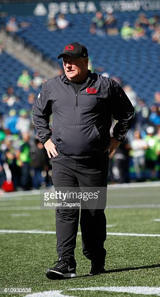 Head Coach Chip Kelly of the San Francisco 49ers stands on the field prior to the game against the Seattle Seahawks at CenturyLink Field on September...