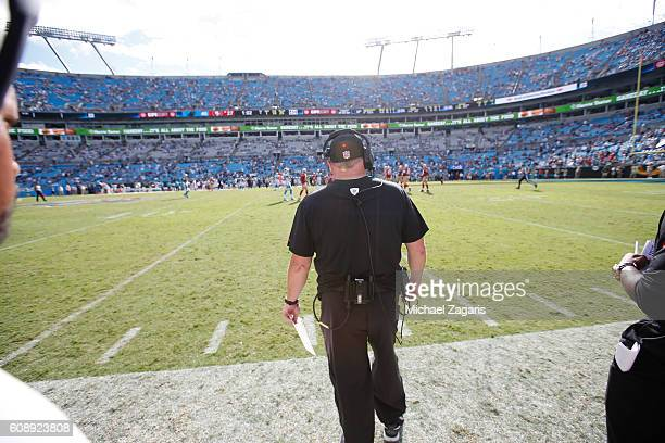 Head Coach Chip Kelly of the San Francisco 49ers stands on the sideline during the game against the Carolina Panthers at Bank of America Stadium on...