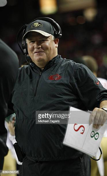Head Coach Chip Kelly of the San Francisco 49ers stands on the sideline during the game against the Atlanta Falcons at the Georgia Dome on December...