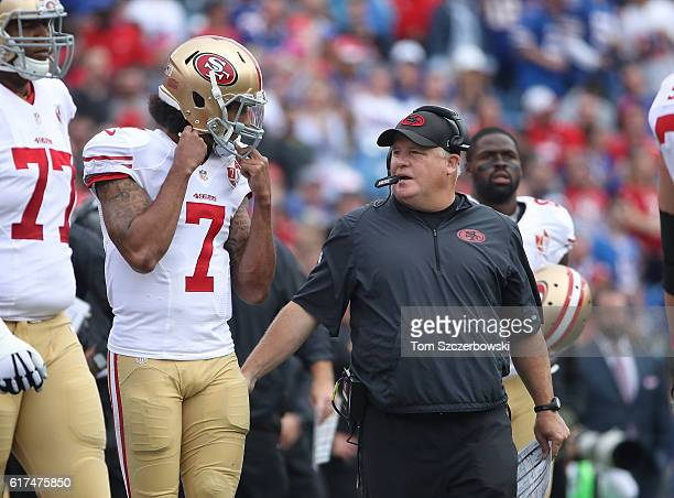 Head coach Chip Kelly of the San Francisco 49ers talks to Colin Kaepernick during NFL game action against the Buffalo Bills at New Era Field on...