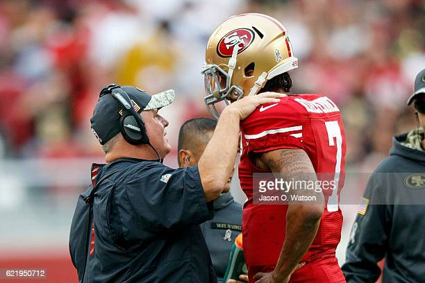 Head coach Chip Kelly of the San Francisco 49ers talks to quarterback Colin Kaepernick during the third quarter against the New Orleans Saints at...