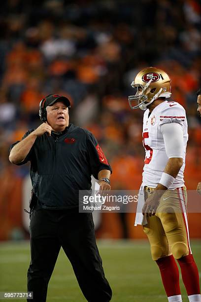 Head Coach Chip Kelly of the San Francisco 49ers talks with Christian Ponder during the game against the Denver Broncos at Sports Authority Field on...