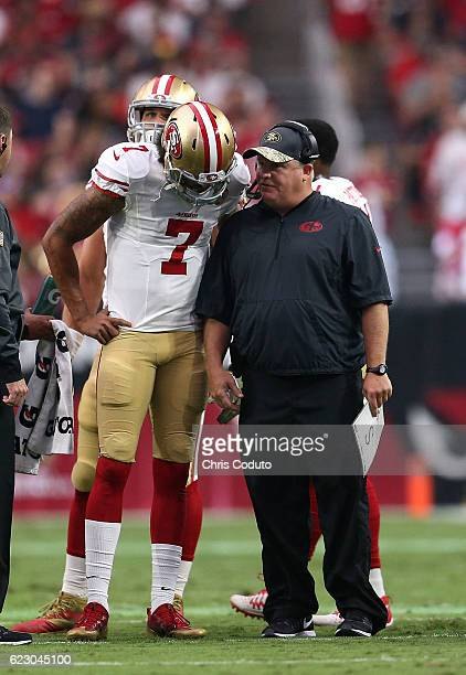 Head coach Chip Kelly of the San Francisco 49ers talks with quarterback Colin Kaepernick during the second quarter of the NFL football game against...