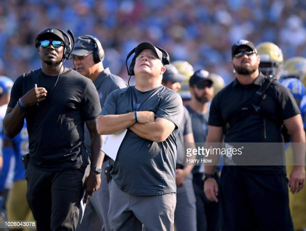 Head coach Chip Kelly of the UCLA Bruins reacts to the second touchdown of Michael Warren II of the Cincinnati Bearcats to take a 14-10 lead during...