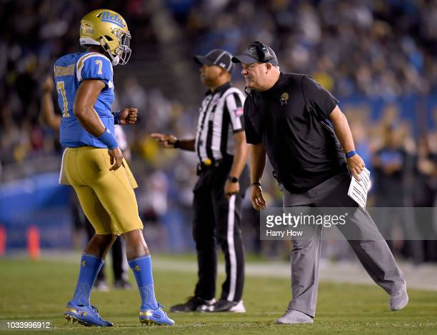 Head coach Chip Kelly of the UCLA Bruins talks with Dorian ThompsonRobinson during the second quarter against the Fresno State Bulldogs at Rose Bowl...