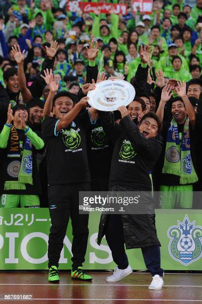 Head coach Cho Kwi Jae and Shonan Bellmare players celerbrate J2 champions and promotion to J1 after the J.League J2 match between Shonan Bellmare...