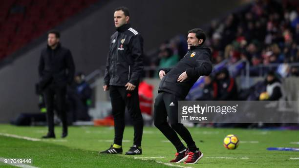 Head coach Cholo Simeone of Atletico Madrid and Head coach Marcelino of Valencia look on during the La Liga match between Atletico Madrid and...