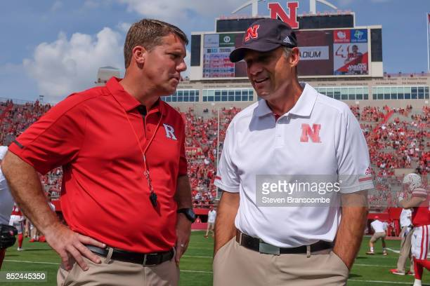 Head coach Chris Ash of the Rutgers Scarlet Knights and head coach Mike Riley of the Nebraska Cornhuskers meet before the game at Memorial Stadium on...