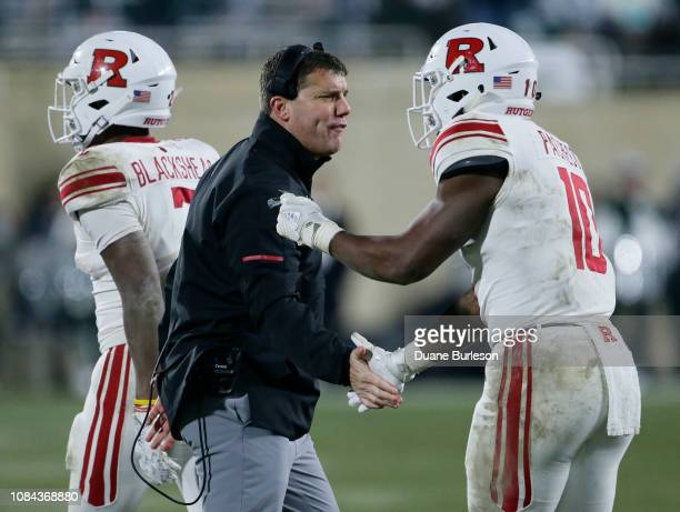 Head coach Chris Ash of the Rutgers Scarlet Knights greets running back Isaih Pacheco of the Rutgers Scarlet Knights during the second half of a game...