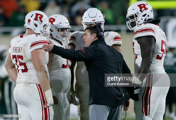 Head coach Chris Ash of the Rutgers Scarlet Knights offensive lineman Zach Venesky of the Rutgers Scarlet Knights during the second half of a game...