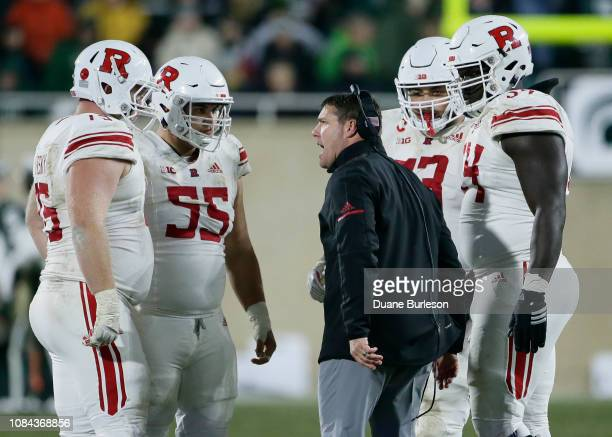 Head coach Chris Ash of the Rutgers Scarlet talks to offensive linemen Zach Venesky Michael Maietti Jonah Jackson and Kamaal Seymour of the Rutgers...