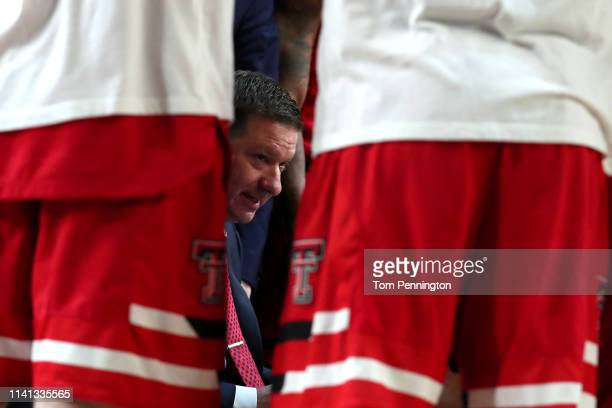 Head coach Chris Beard of the Texas Tech Red Raiders speaks to his team during a timeout against the Virginia Cavaliers in the first half during the...
