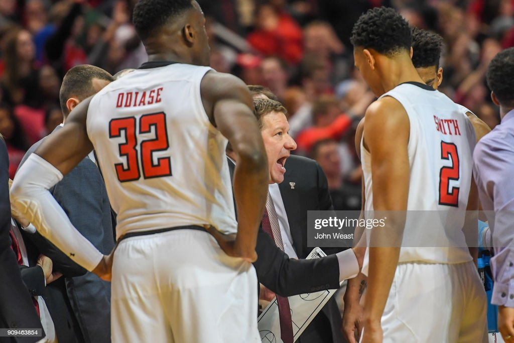 Head coach Chris Beard of the Texas Tech Red Raiders talks to his team at a time out during the second half of the game against the Oklahoma State Cowboys on January 23, 2018 at United Supermarket Arena in Lubbock, Texas. Texas Tech defeated Oklahoma State 75-70.