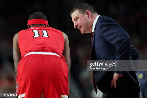 Head coach Chris Beard speaks with Tariq Owens of the Texas Tech Red Raiders against the Virginia Cavaliers in the first half during the 2019 NCAA...
