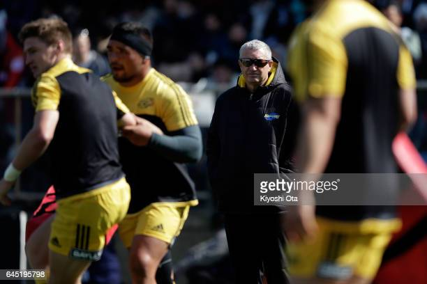 Head coach Chris Boyd of the Hurricanes watches his players warming up prior to the Super Rugby Rd 1 game between Sunwolves and Hurricanes at Prince...