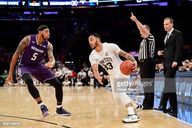 Head coach Chris Collins looks on as Derek Pardon of the Northwestern Wildcats defends Step Garner of the Penn State Nittany Lions during the second...
