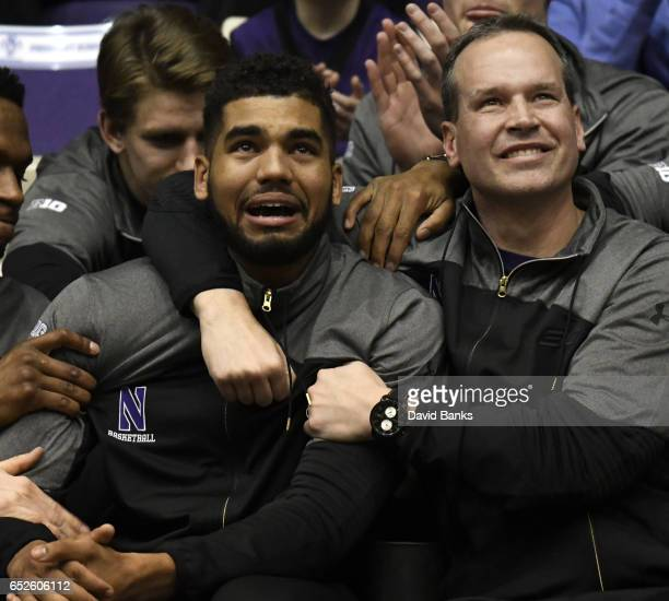 Head coach Chris Collins of the Northwestern Wildcats and Sanjay Lumpkin react after their team was selected to play Vanderbilt during a NCAA...