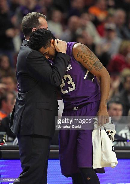 Head coach Chris Collins of the Northwestern Wildcats hugs senior JerShon Cobb as he is taken out of the game against the Indiana Hoosiers during the...