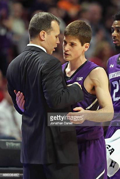 Head coach Chris Collins of the Northwestern Wildcats hugs senior Dave Sobolewski as he is taken out of the game against the Indiana Hoosiers during...
