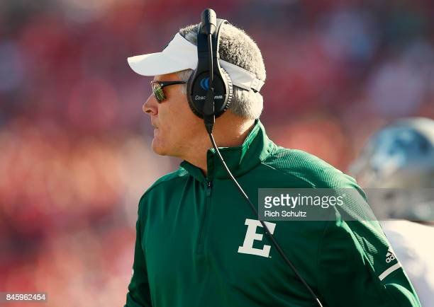 Head coach Chris Creighton of the Eastern Michigan Eagles looks on at the action against the Rutgers Scarlet Knights during the first quarter of a...