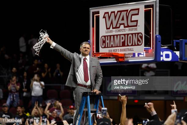 Head Coach Chris Jans of the New Mexico State Aggies celebrates after winning the championship game of the Western Athletic Conference basketball...