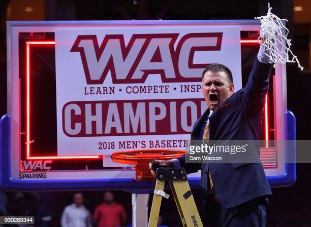 Head coach Chris Jans of the New Mexico State Aggies hold up the net after defeating the Grand Canyon Lopes 7258 in the championship game of the...