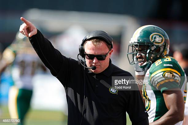 Head coach Chris Jones of the Edmonton Eskimos signals to players against their game against the Calgary Stampeders in the second half of their CFL...