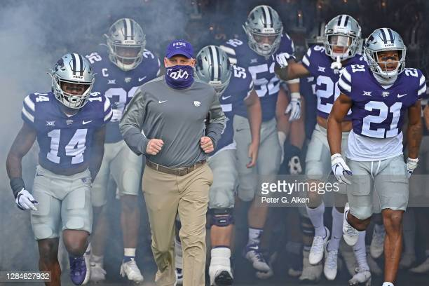 Head coach Chris Klieman of the Kansas State Wildcats leads his team out onto the field, prior to a game against the Oklahoma State Cowboys at Bill...