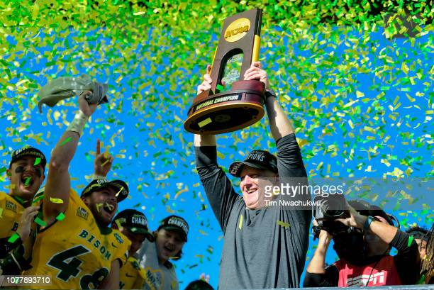 Head coach Chris Klieman of the North Dakota State Bison celebrates defeating the Eastern Washington Eagles during the Division I FCS Football...