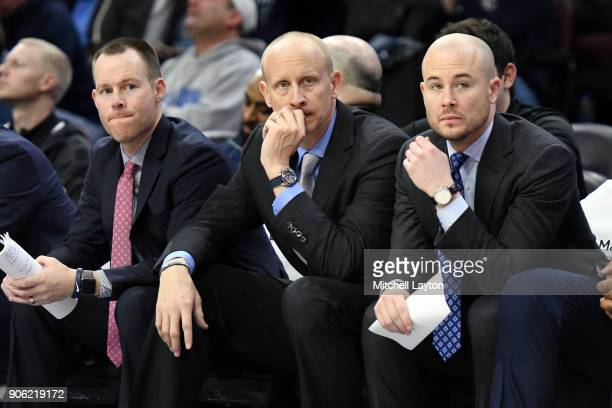 Head coach Chris Mack of the Xavier Musketeers looks on with his assistant coaches Travis Steele and Luke Murray during a college basketball game...