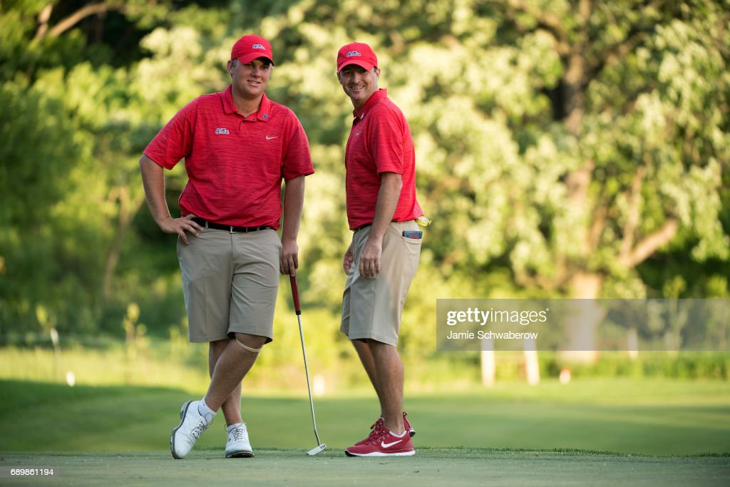 Head Coach Chris Malloy and Braden Thornberry of Ole Miss share a moment on the 18th green during the Division I Men's Golf Individual Championship held at Rich Harvest Farms on May 29, 2017 in Sugar Grove, Illinois. Thornberry won the individual national title with a -11 score.